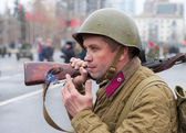 Member of Historical reenactment in Soviet Army uniform after battle — Stock Photo