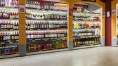 Showcase alcoholic beverages at the hypermarket METRO — Stok fotoğraf
