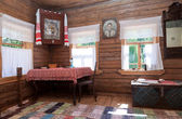 Interior of old rural wooden house in the museum of wooden archi — Stock Photo