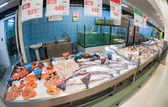 Raw fish ready for sale in the hypermarket Karusel — Stock Photo