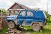 Old, dirty UAZ car repaired in a village — Stock Photo