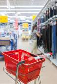 Empty red shopping cart Auchan store — Stockfoto