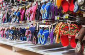 Different slippers ready to sale at showcase in new hypermarket — Stock Photo