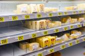 Sale of cheese in the hypermarket Auchan — Stock Photo