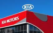 The emblem KIA motors on blue sky background — Stock Photo