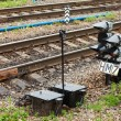 View of the railway track and traffic light on a summer day — Stock Photo #63334937