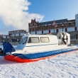 Hovercraft on the bank of a frozen river — Stock Photo #63598463