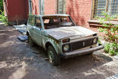 Abandoned broken russian automobile Lada at the abandoned town i — Stock Photo