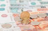 Russian currency, rouble: banknotes and coins close up — Stock Photo