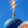 Dome of Russian orthodox church with cross against blue sky — Stock Photo #70651339