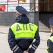 Russian police officers standing by the road in lime-colored uni — Stock Photo #71704717