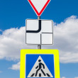 Traffic signs main road and pedestrian crossing with clouds in b — Stock Photo #72844427