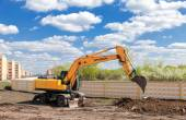 Hyundai excavator at construction site in summer sunny day — Stock Photo