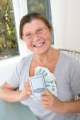 Elderly woman with Russian money and savings book — Stock Photo