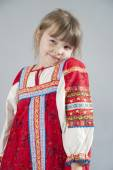 Little girl in a cunning Russian folk costume — Stock Photo