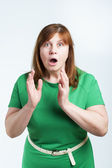 Surprised middle-aged woman — Stock Photo