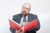 Business man studies folder with documents — Stock Photo