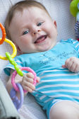 Newborn baby playing with a toy-suspension — Stock Photo