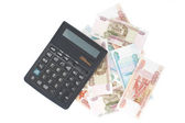 Russian money and calculator on white background — Stock Photo