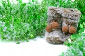 Green tinsel with snow boots decoration — Stock Photo