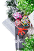 Top view on christmas present boxes and tinsel — Stock Photo