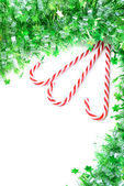 Green tinsel with candy canes decoration — Foto Stock