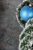 Christmas decorations - ball and spruce tinsel — Stock Photo