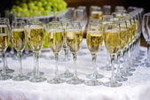 Glasses of champagne waiting for guests — Stock Photo