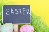 Miniature chalkboard with easter eggs — Stock Photo