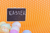 Easter eggs with blackboard — Stock Photo