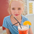 Little girl drinking orange juice — Stock Photo #69471239