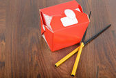 Chinese take away red food box with chopstocks — Stock Photo