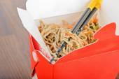 Meat and noodles in red take away container — Stock Photo