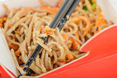 Noodles in red take away container — Stock Photo