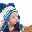 Portrait of adorable baby in knitted hat — Stock Photo #70679437