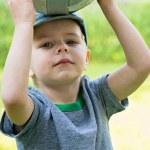 Little boy holding sport ball — Stock Photo #78859408