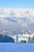 The woman at the view winter mountain. Ski resort Schladming . A — Stockfoto