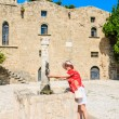 A tourist in the old town at the source of water. Rhodes. Greece — Stock Photo #62550723