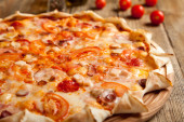 "Italian pizza ""Bavarian"" on a wooden table. — Stock Photo"