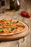 "Italian pizza ""Vegetarian"" on a wooden table. — Stock Photo"