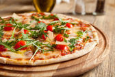 "Italian pizza ""Caprese"" on a wooden table. — Stock Photo"
