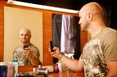 Man photographs herself in the mirror — Stock Photo
