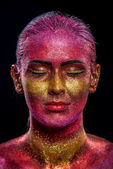 Glitter makeup on a beautiful woman face on a black background — Stock Photo