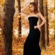 Hot young woman in autumn park — Stock Photo #55605151