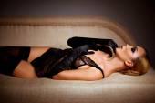Woman in black stockings — Stock Photo