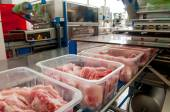 Lumps of meat in a container — Stock Photo
