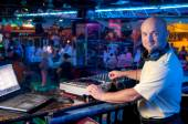 DJ behind the control panel — Stock Photo