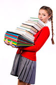 Girl standing with a bunch of books — Stock Photo