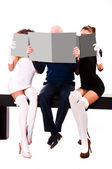 Two women and a man — Stock Photo