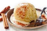 Baked apple with vanilla sauce — Stock Photo